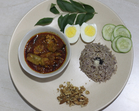 Small chicken curry with brown rice  walnut  hard boiled egg and cucumber